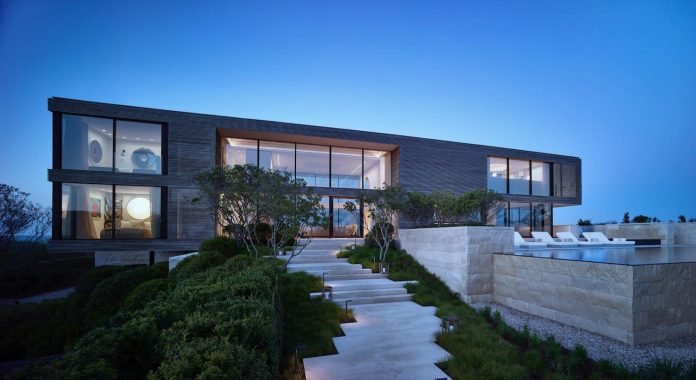 perched-ocean-pond-field-house-almost-appears-allow-landscape-run-24