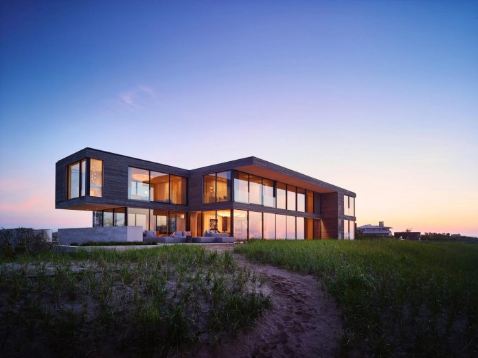 perched-ocean-pond-field-house-almost-appears-allow-landscape-run-25