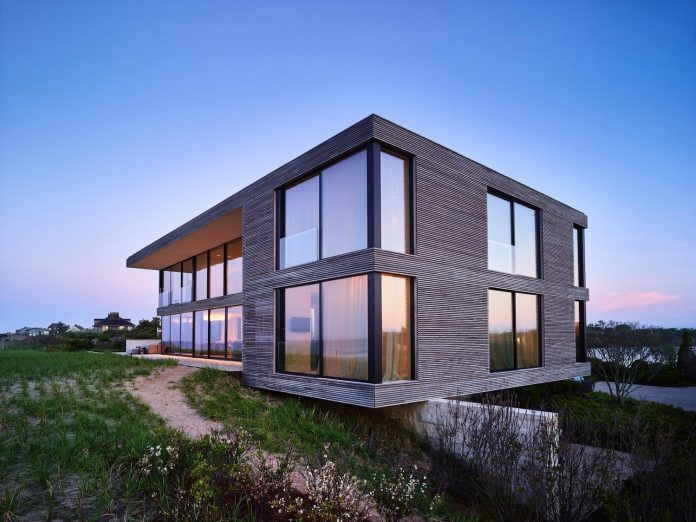 perched-ocean-pond-field-house-almost-appears-allow-landscape-run-26