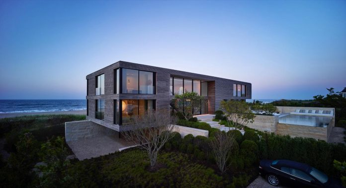 perched-ocean-pond-field-house-almost-appears-allow-landscape-run-27