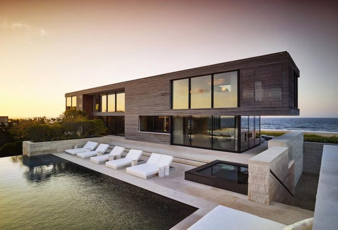 perched-ocean-pond-field-house-almost-appears-allow-landscape-run-28