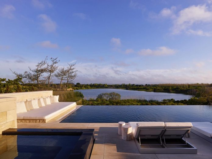 perched-ocean-pond-field-house-almost-appears-allow-landscape-run-30