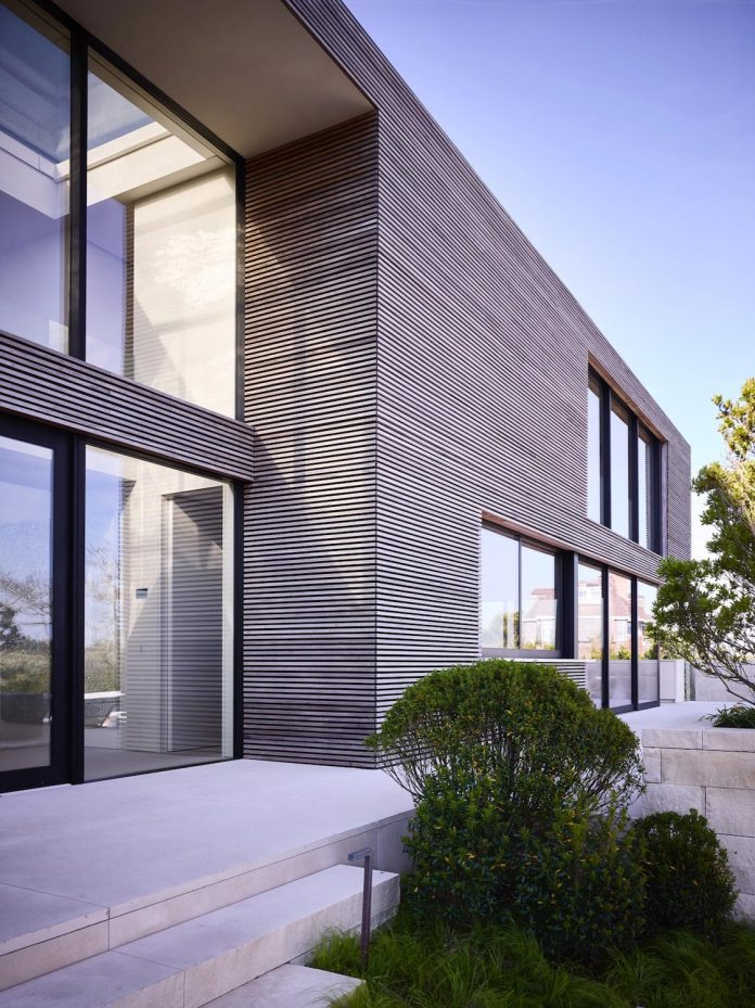 perched-ocean-pond-field-house-almost-appears-allow-landscape-run-31