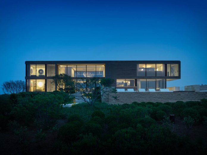 perched-ocean-pond-field-house-almost-appears-allow-landscape-run-44