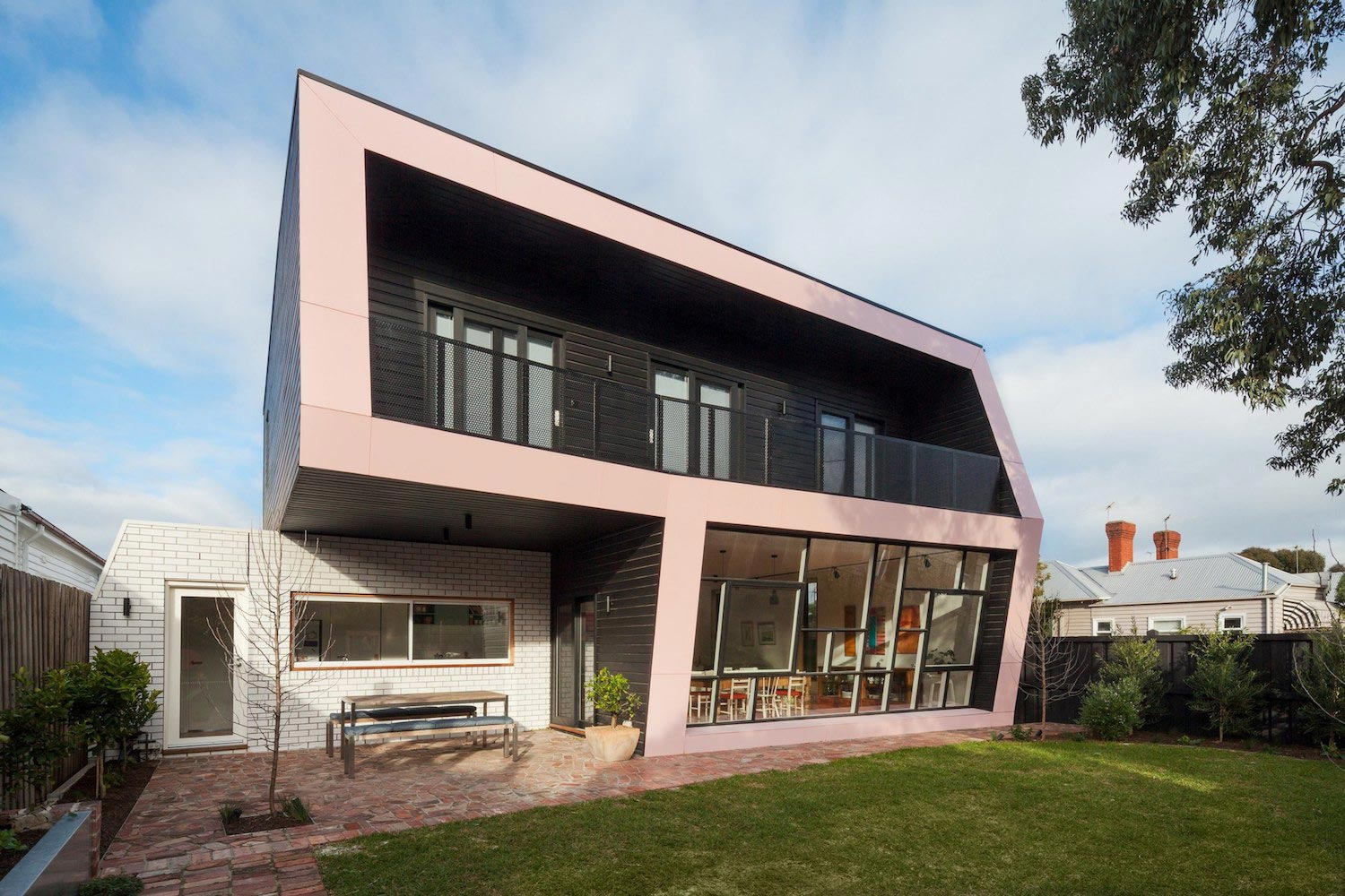 Reconfiguration and extension of an edwardian weatherboard for Beach house designs melbourne
