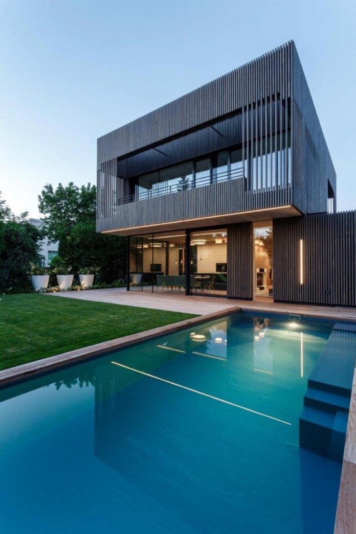 residence-situated-middle-block-buildings-created-satisfy-family-needs-05
