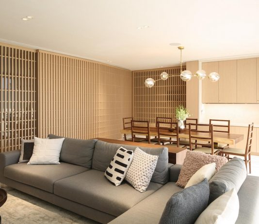 Simple home for a growing family with many operable screens to open or separate the space