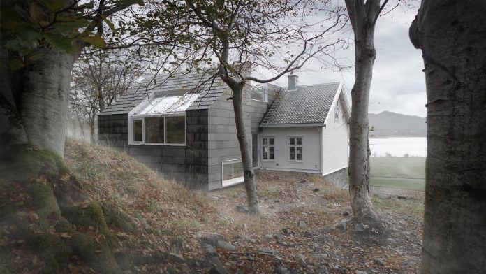 slate-extension-sits-like-rock-next-twin-protects-strong-sea-wind-03