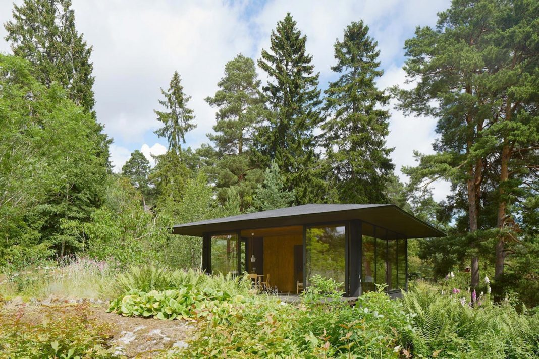 Summerhouse T A Small House Situated By A Lake In The