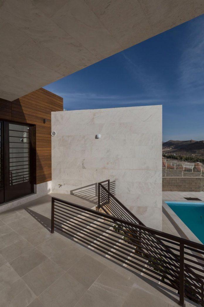 weekend-villa-located-hillside-sadra-city-09