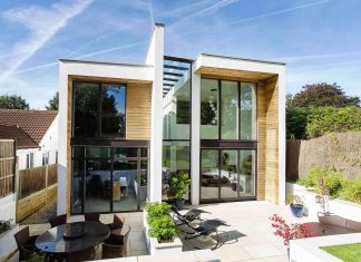 2 storey family home with glazed atrium that brings light deep into the house