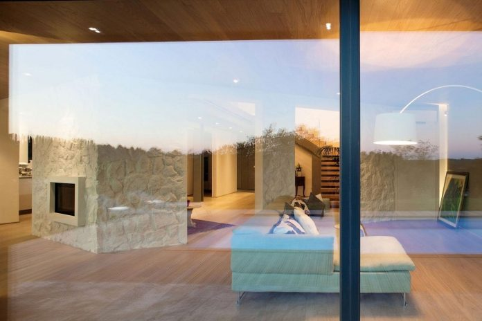 complex-geometry-new-two-levels-house-flood-natural-light-open-surrounding-hills-03