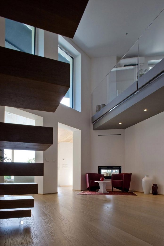 complex-geometry-new-two-levels-house-flood-natural-light-open-surrounding-hills-05