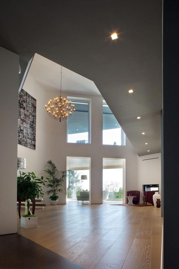 complex-geometry-new-two-levels-house-flood-natural-light-open-surrounding-hills-06