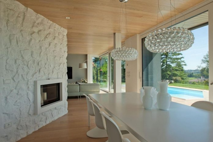complex-geometry-new-two-levels-house-flood-natural-light-open-surrounding-hills-08