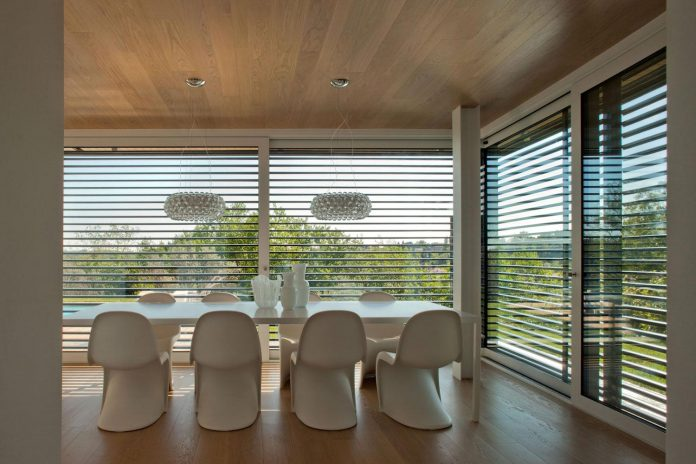 complex-geometry-new-two-levels-house-flood-natural-light-open-surrounding-hills-09
