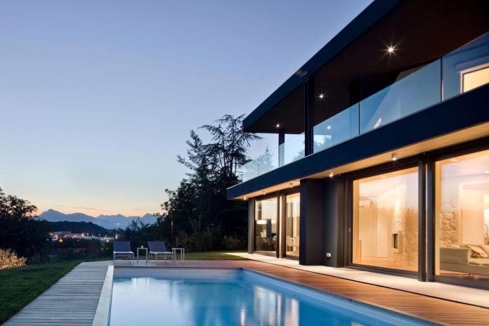 complex-geometry-new-two-levels-house-flood-natural-light-open-surrounding-hills-13