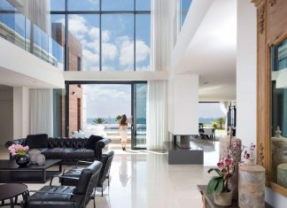 Contemporary house overlooks the Mediterranean sea, situated steps away from the beach