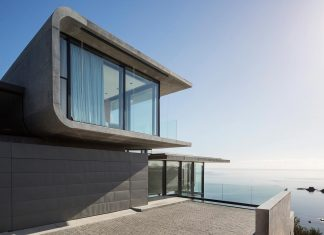 Contemporary house above a rocky cove on Waiheke Island in Auckland's Hauraki Gulf