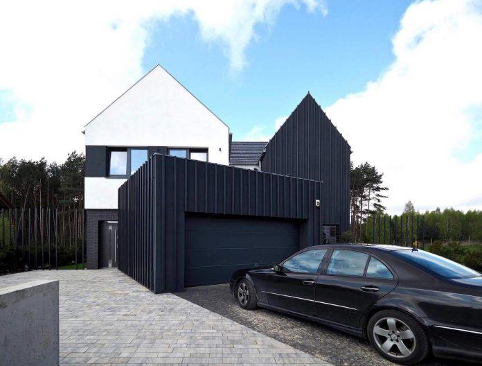 contemporary-interpretation-traditional-style-home-borowiec-poland-02