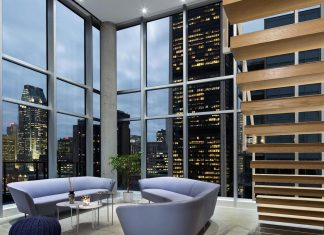 Contemporary penthouse minimally dressed, white predominant, designed for some students