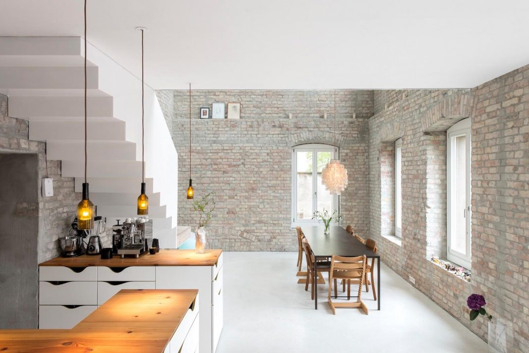 Conversion of an old miller's house into a home for a family with three kids