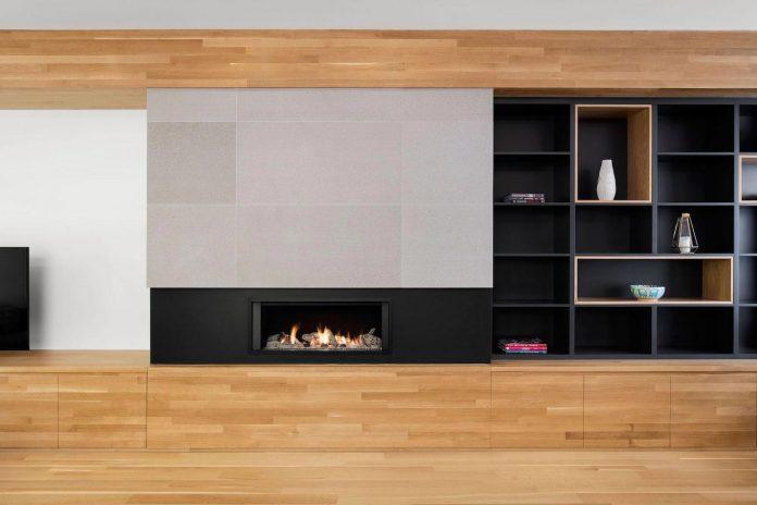 duplex-facing-lafontaine-park-wood-surfaces-extend-continuously-space-02