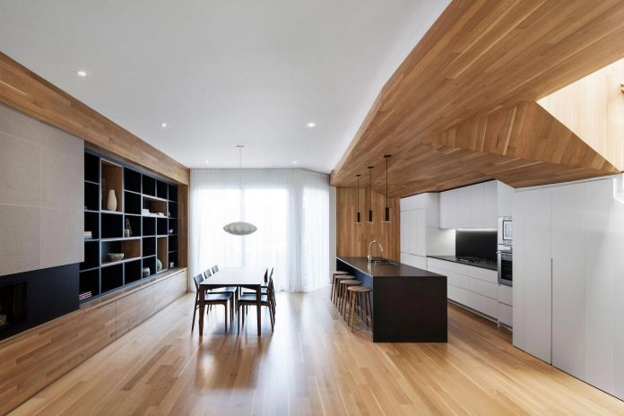 duplex-facing-lafontaine-park-wood-surfaces-extend-continuously-space-04