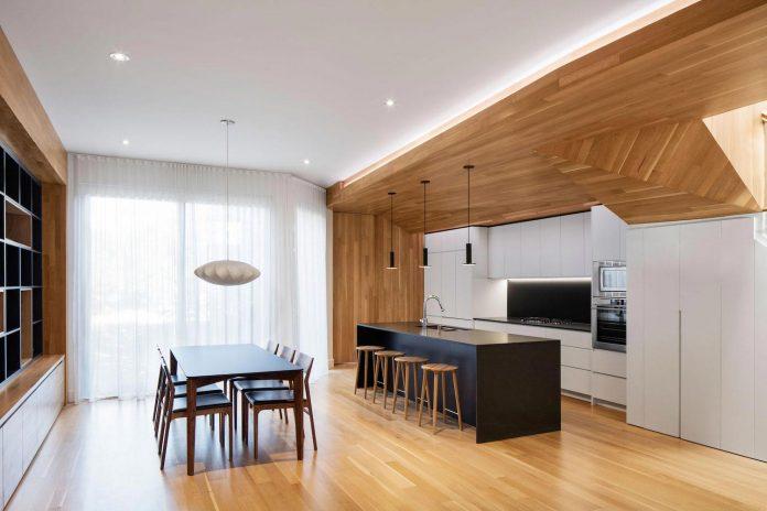 duplex-facing-lafontaine-park-wood-surfaces-extend-continuously-space-05