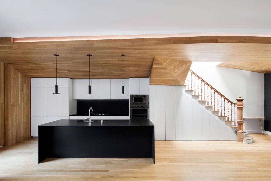 Duplex facing Lafontaine Park has wood surfaces that extend continuously into the space