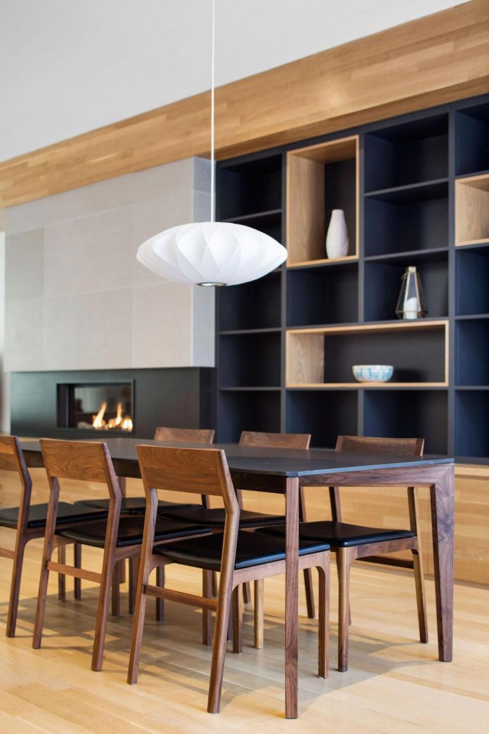 duplex-facing-lafontaine-park-wood-surfaces-extend-continuously-space-10