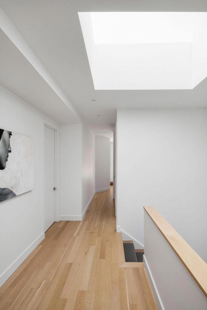 duplex-facing-lafontaine-park-wood-surfaces-extend-continuously-space-11