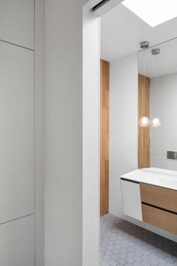 duplex-facing-lafontaine-park-wood-surfaces-extend-continuously-space-14