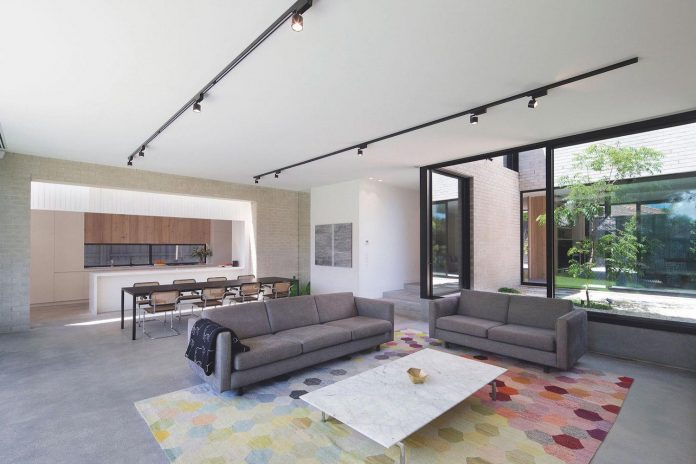 hiding-house-contemporary-compact-house-features-reduce-energy-use-06