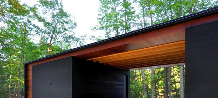 linear-cabin-small-unassuming-family-retreat-woods-02