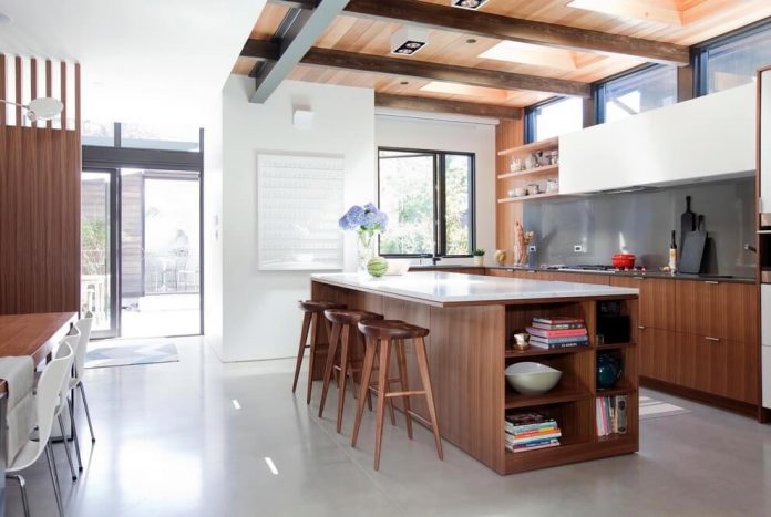 Mid-century home design with exposed structural steel I-beam and ...