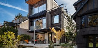 Mid-century home design with exposed structural steel I-beam and clear fir wood ceilings