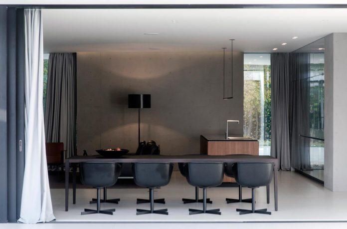 single-storey-pavilion-glass-concrete-wood-located-suburbs-chisinau-08