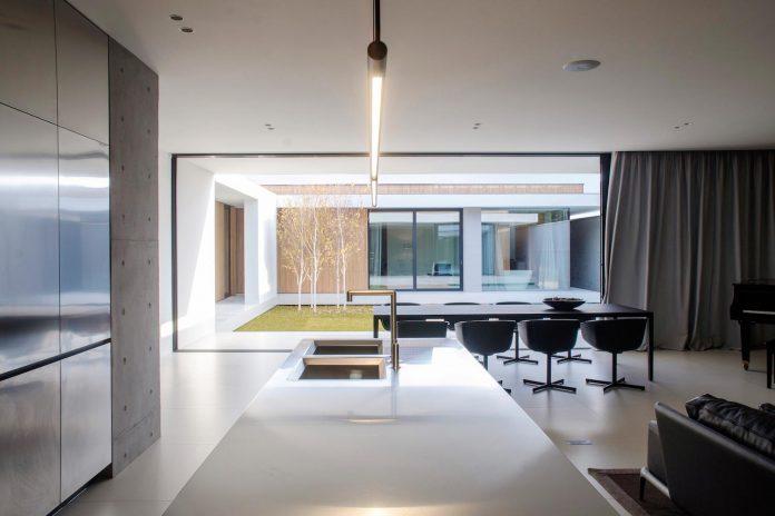 single-storey-pavilion-glass-concrete-wood-located-suburbs-chisinau-16
