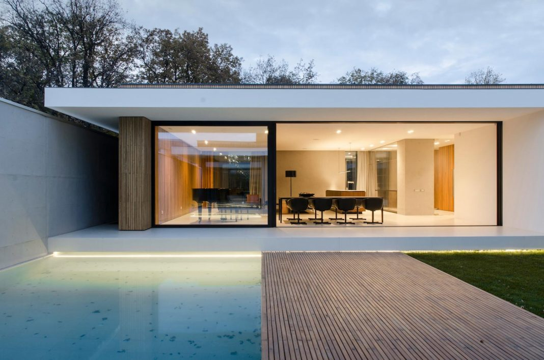 A Single Storey Pavilion Of Glass Concrete And Wood Located In The