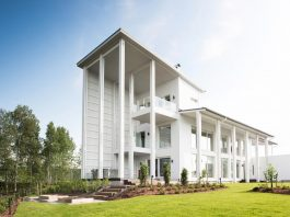 Villa Muurame is a wooden 3-story, bright and white single-family home located near Lake Jyväsjärvi, Finland