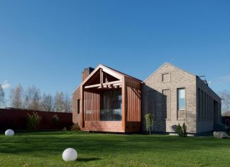 Brick and wood work of art of the Shatura House locate near Moscow