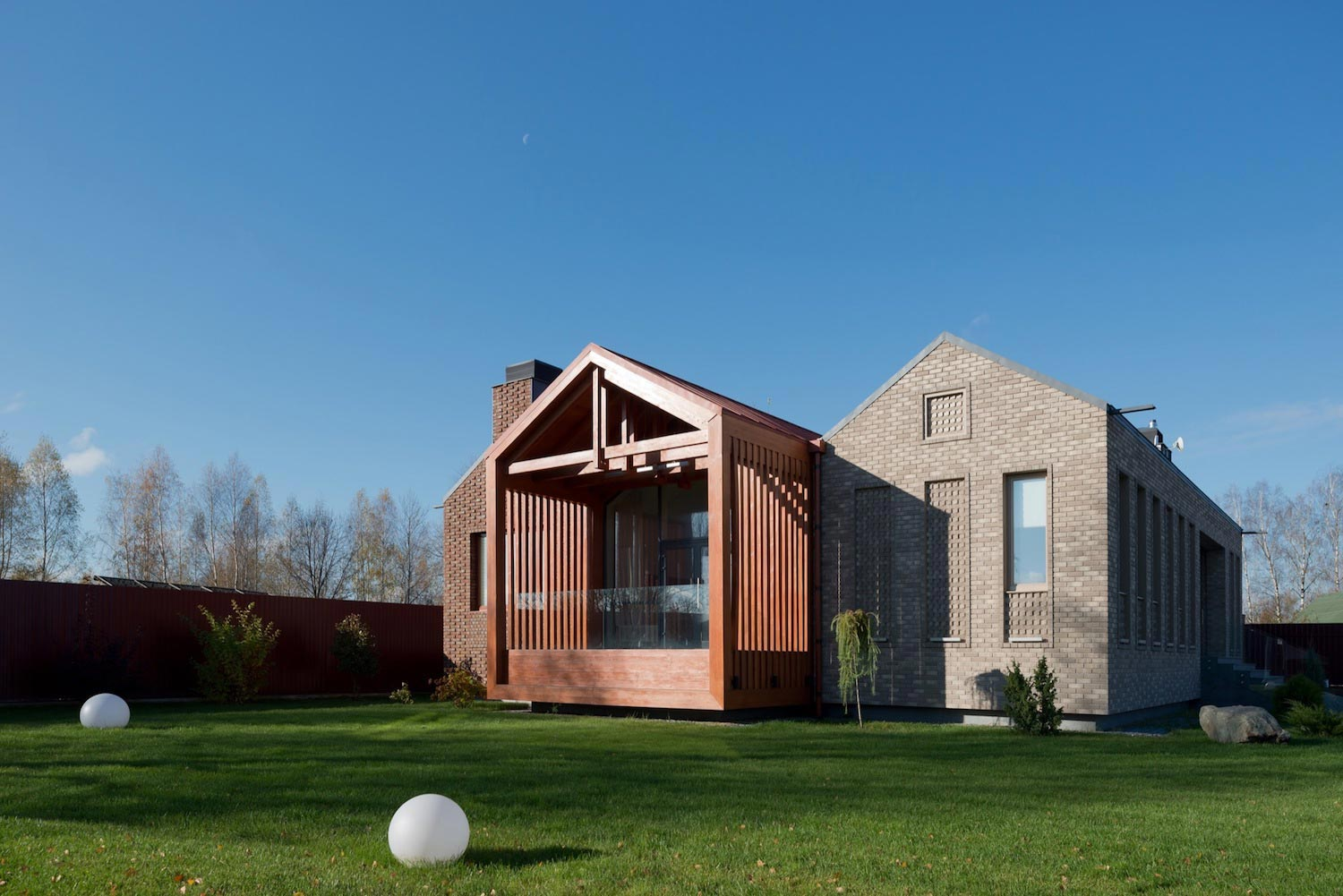 Brick and wood work of art of the shatura house locate for Brick and wood home designs