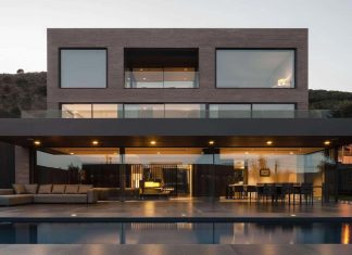 Contemporary home in Barcelona covered in dark brick shaped ceramic