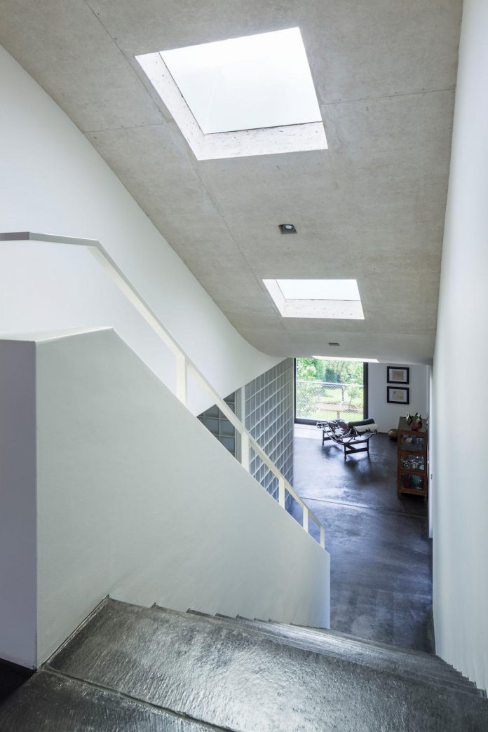 Curved Shape Of The Roof Connects The Two Floors And Turns