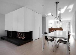 Immaculate white adds a lot of light in contrast with the black and walnut wood elements