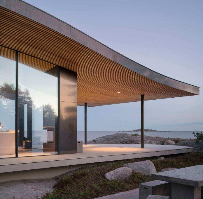 glass pavilion by Anttinen Oiva Architects