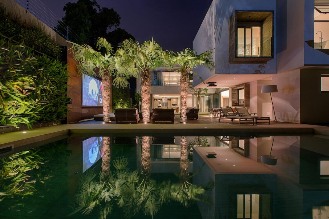 Inner Backyard With Home Theatre And Swimming Pool Of The MLD House