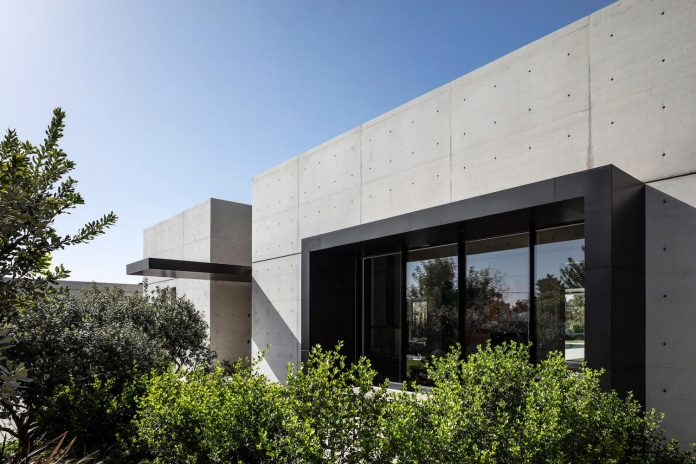 Minimalist Concrete And Glass House Consists Of Two Volumes