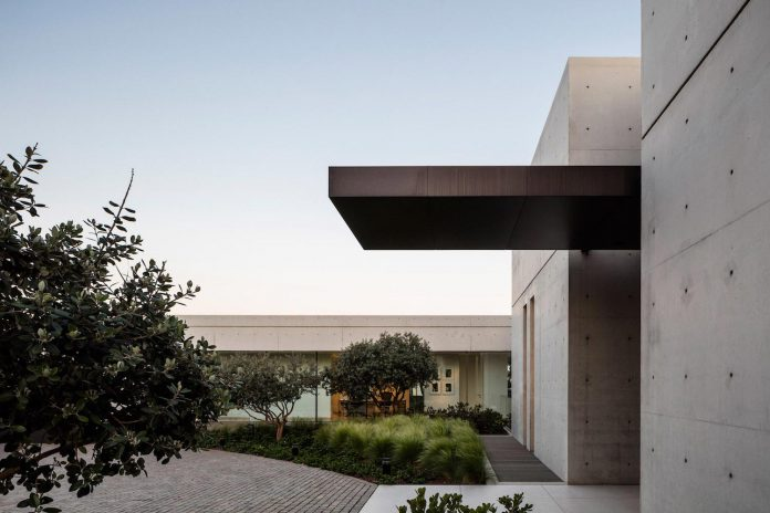Minimalist concrete and glass house consists of two for Concrete minimalist house